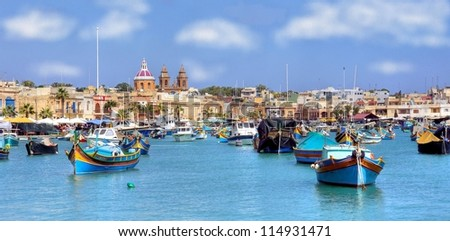 traditional fishing boats in the harbour of Marsaxlokk , Malta