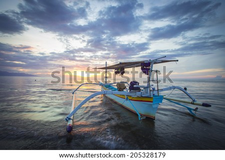 Traditional fishing boats on a beach in Lovina on Bali. Indonesia - stock photo