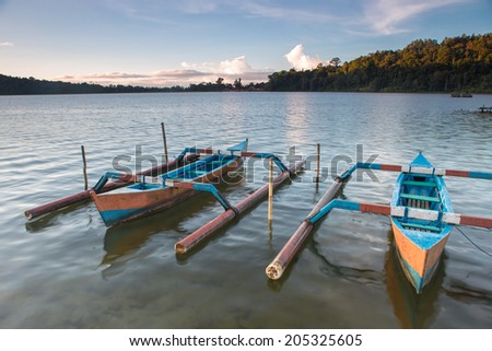 Traditional fishing boats on a beach in Sanur on Bali. Indonesia - stock photo
