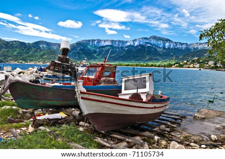 traditional fishing boats waiting for evening on the beautiful greek island of thassos. - stock photo