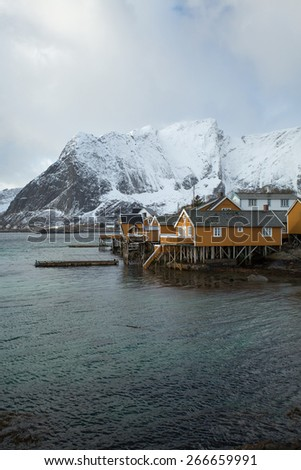 Traditional fishing cabins in Reine, Lofoten, Norway - stock photo