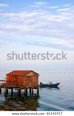 Traditional fishing house where the Po River meets the Adriatic sea, Italy. - stock photo