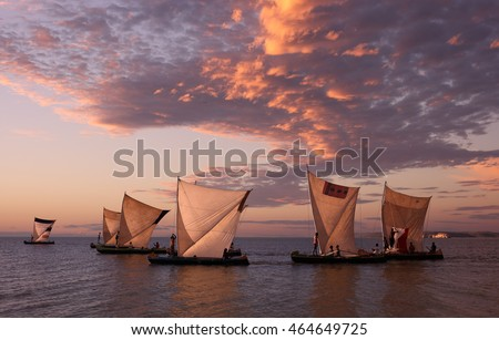 Traditional fishing pirogues with dramatic sky at sunset in Anakao, Madagascar