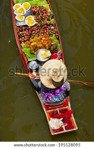 Traditional floating market in Damnoen Saduak near Bangkok - stock photo