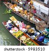 Traditional floating market near Bangkok, Thailand. - stock photo