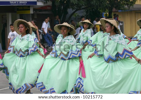"Traditional folk-dancers in the ""Saulug de Tanjay"" parade - stock photo"