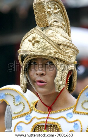 """Traditional folk-dancers in the """"Saulug de Tanjay"""" parade, in Negros Oriental, Vasayas, Philippines.  The Saulug is an annual event in honor of St. James, the patron saint of the town Tanjay. - stock photo"""