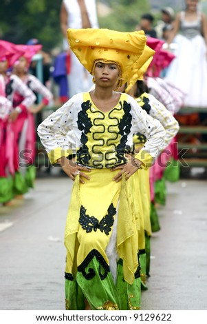 """Traditional folk-dancers in the """"Saulug de Tanjay"""" parde, in Negros Oriental, Philippines. - stock photo"""
