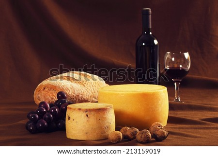 Traditional food and wine on vintage canvas - stock photo