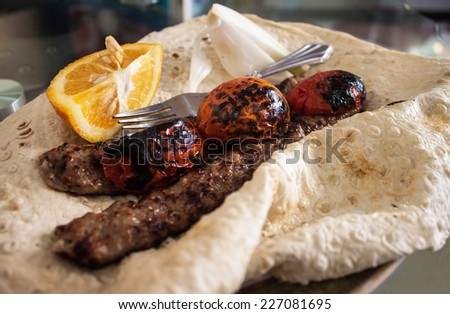 Traditional food in Iran - kabab with flat bread - stock photo