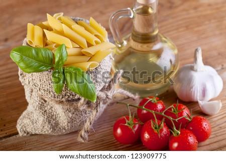 Traditional food ingredients detail - pasta and fresh seasoning - stock photo