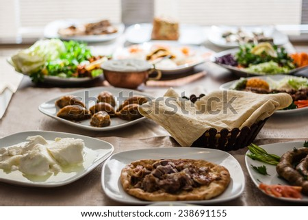 Traditional foods like mumbar, buryan, kebab, baklava from Turkish cuisine - stock photo