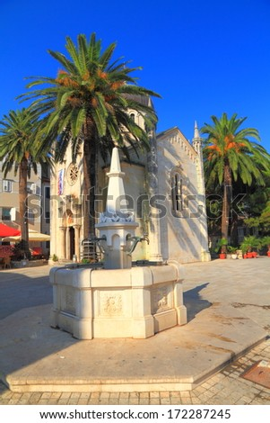 Traditional fountain and stone church of Mediterranean town