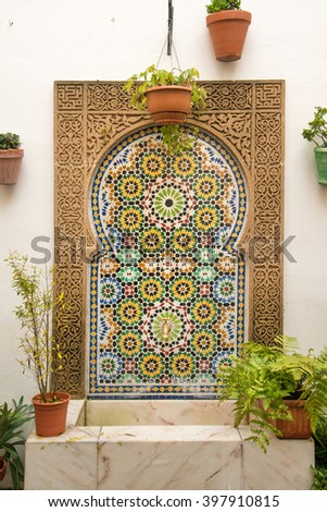 Traditional fountain in Spanish tiles in courtyard of Cordoba house