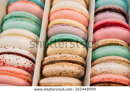 traditional french colorful macarons in a box - stock photo