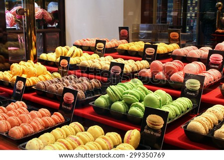 Traditional french colorful macarons in a cafe - stock photo