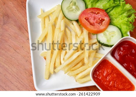 Traditional french fries with gravy and vegetables - stock photo