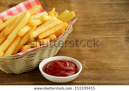Traditional French fries with ketchup - stock photo