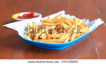 Traditional French fries with ketchup.