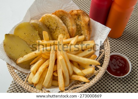 Traditional French fries with ketchup and bread