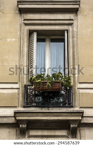 Traditional French house with typical balconies and windows. Paris, France.