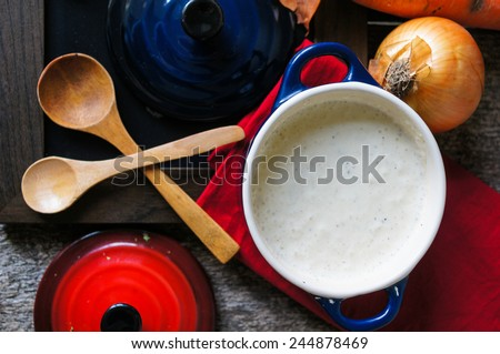 Traditional french onion cream soup on the wooden table - stock photo
