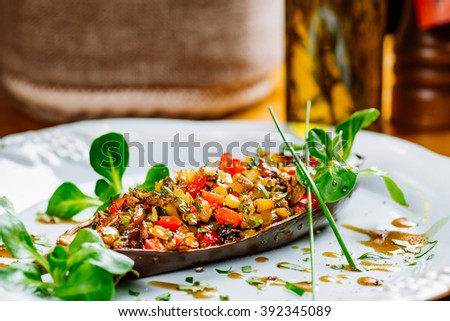 Traditional french ratatouille with vegetables and herbs on table background for the restaurant menu - stock photo