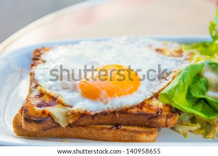Traditional French Toasted Sandwich - croque madame - stock photo