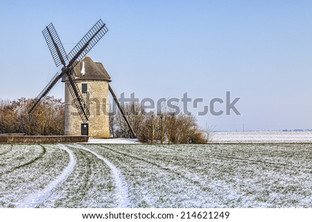 Traditional French windmill during the winter season, located in Eure et Loir region in Central France - stock photo
