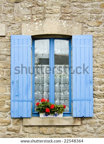 Traditional French window with shutters - stock photo