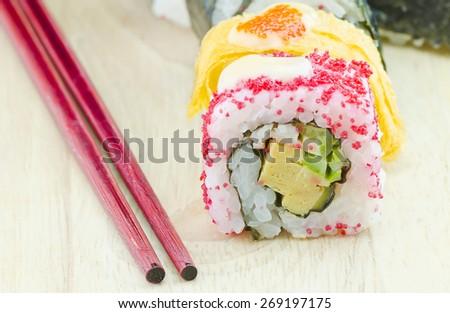traditional fresh japanese sushi rolls on wooden background,shllow DOF - stock photo