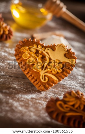 Traditional freshly baked gingerbread or honeybread hearts from Slovenia. - stock photo