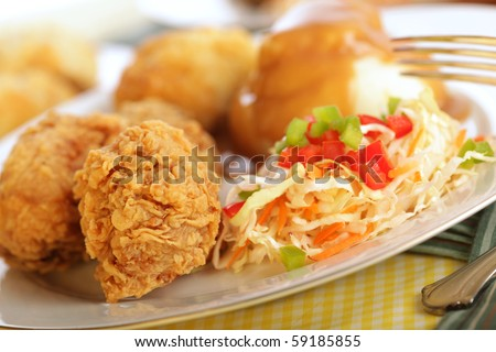 Traditional fried chicken dinner with silver fork - stock photo