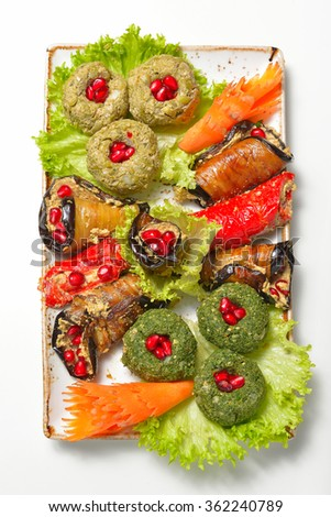 traditional Georgian cuisine - vegetable rolls and pates nut paste (pkhali) - stock photo