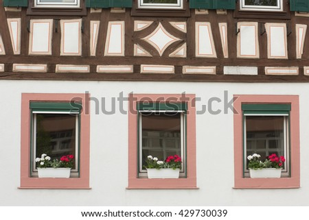 Traditional german fachwerk house and windows. Natural light. Selective focus.