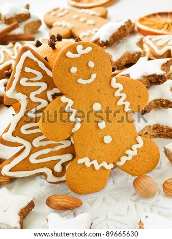 Traditional gingerbread and cinnamon Zimtsterne cookies. Shallow dof. - stock photo