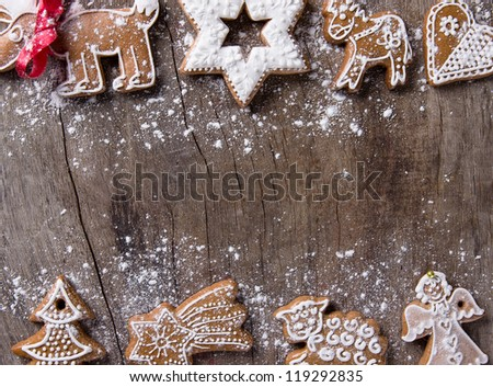 Traditional gingerbread cookies over wooden background - stock photo