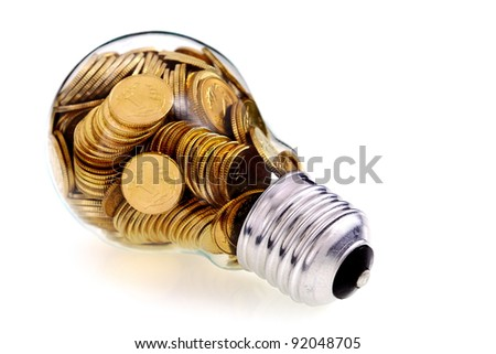 Traditional glass bulb and energy savings - stock photo