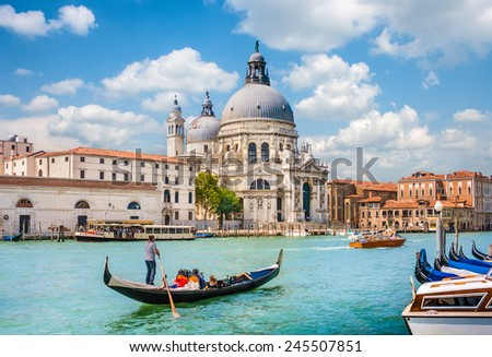 Traditional Gondola on Canal Grande with Basilica di Santa Maria della Salute in the background, Venice, Italy - stock photo