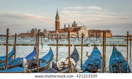 Traditional gondolas with the bell tower of the Saint Giorgio Maggiore Church on background (view from San Marco embankment) - Venice, Italy - stock photo