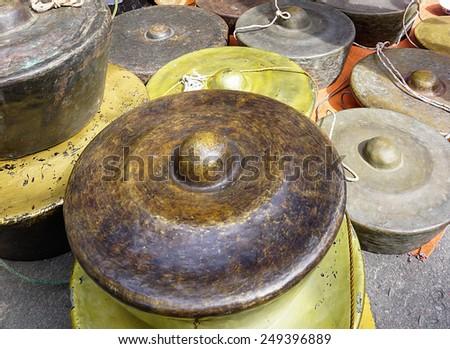 Traditional gongs on display during Sunday market at Gaya Street Sabah, Borneo, Malaysia  - stock photo