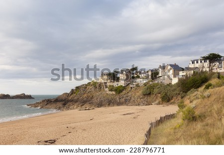 Traditional granite houses on cliffs in Saint-Malo - Plage du Val, Saint-Malo, Brittany, France - stock photo