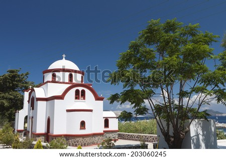 Traditional Greek church at Mandraki village of Nisyros island in Greece - stock photo