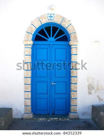 traditional Greek church blue door - stock photo