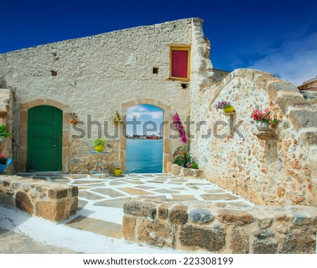 Traditional greek door with a great view on Crete island, Greece - stock photo