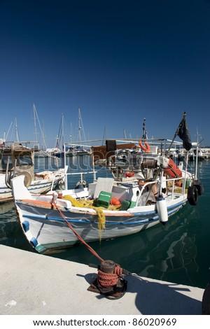 Traditional greek fishing boat - stock photo