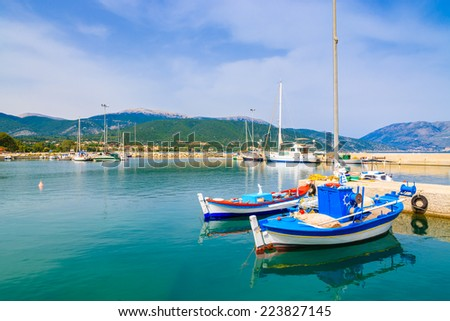 Traditional Greek fishing boats in port of Sami village on Kefalonia island, Greece - stock photo