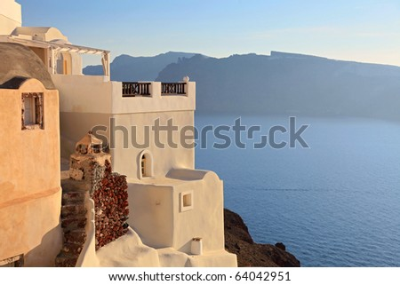 Traditional Greek house at sunset (Oia; Santorini; Greece) - stock photo