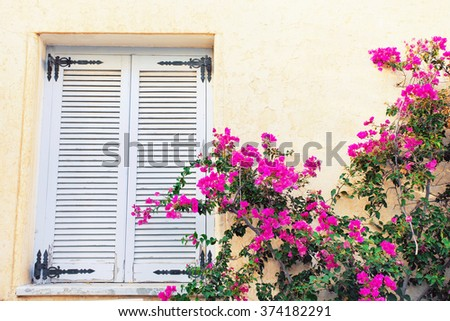 Traditional greek house with flowers, Greece. - stock photo