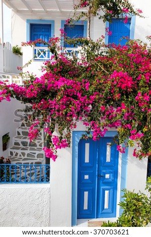 Traditional greek house with flowers in Oia village on Santorini island, Greece - stock photo
